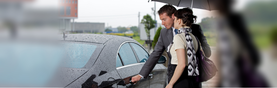 man assisting woman getting inside the car